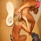 Blonde MILF gets her holes stuffed in bathroom