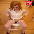 This horny mature slut gets raunchy on the toilet