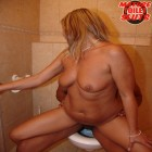 Horny mature slut doing nasty stuff in a public restroom