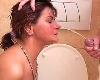 Mature housewife sucks dick and ass in the toilet