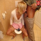 This blonde whore gets fucked on the crapper